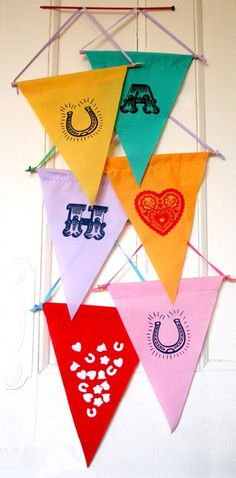 felt banners.might be cute to hang one with a milagro or heart image somewhere i just like them