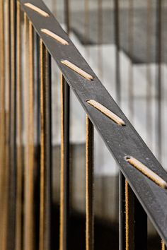 leather lacing embellishment to steel railing.  @Susan Caron Caron Seward