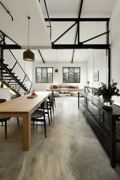 Polished concrete floor + industrial aesthetic + steel trusses and stairs + clean furniture Melbourne loft Techne