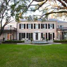 elegant, contrast, light brick, white window detail and dark shutters, beautiful lawn, nice detail on balcony/patio but don't like the columns - would rather more substantial traditional white to the intricate iron look