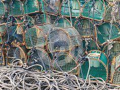 LUARCA, SPAIN - DECEMBER 4, 2016: Lobster traps at the fish market pier in Luarca, Spain.