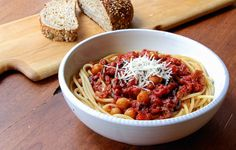 Great vegetarian dinner of spaghetti with chickpeas and spicy tomato sauce using roasted tomatoes.