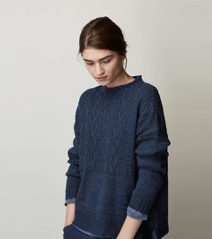 Easy, slightly swingy, Guernsey pullover in a weighty, textured wool/linen. Ribbed, rolled edge neck. Dropped shoulders. Long sleeves. Split hem.: