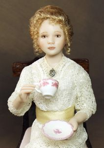 """Tea & Biscuits"" Miniature Doll by Lisa Johnson-Richards - Rosetta is an Edwardian miss wearing a 3-tier cream dress made using delicate vintage lace from early 1900s. The tea cup & saucer are made by Stokesay Ware / http://www.lisajohnsonrichards.com"