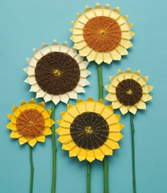 Take a yellow paper plate or paint a white plate yellow. Cut petals evenly along sides. Wrap yellow yarn crosswise around petals. Use green or brown or any color to weave back and forth through the yarn starting in the middle of the flower and working out.