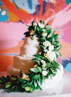Four tier ivory wedding cake garnished with eucalyptus and florals: http://www.stylemepretty.com/2016/9/21/a-fashion-designer-chef-meet-on-the-subway-and-fall-in-love/ Photography: Kayla Barker - http://www.kaylabarker.com/