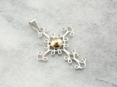 Gorgeous workmanship makes this vintage sterling pendant truly a piece to behold! Weve upgraded this handsome piece a bit, by mounting a 14 karat gold ball at the center.    Metal: Sterling Silver  Metal: 14 Karat Yellow Gold  Measures: 50 x 32 mm    SKU #: W156MV-N    Each piece has been identified and graded by a Graduate Gemologist who has been certified by the Gemological Institute of America (GIA). We have three brick and mortar storefronts in Massachusetts and New Hampshire and have…