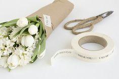 fresh flowers wrapped in kraft paper - so pretty