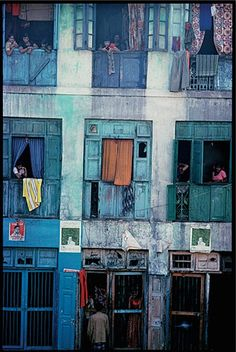 On Falkland Road some of the prostitutes attract customers from cages on the street level, Falkland Road, Bombay, India, 1978