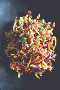 Summer Slaw: into a large bowl, shred: a few carrots, a golden beet, a large fennel bulb, and a head of red cabbage. pour over a vinaigrette of olive oil, mustard, and apple cider vinegar. mix to combine. add some green onion and season with salt and pepper.