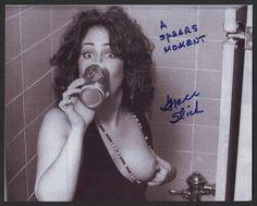 Autographed left breast photograph.