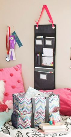 Thirty-One Hang-Up Family Organizer. I like the idea of hanging it with ribbon.