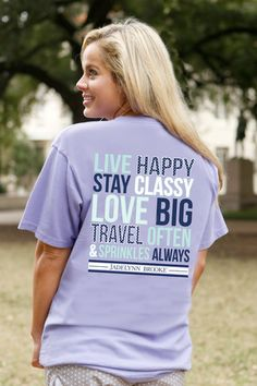 "Live Happy. Stay Classy. Love Big. Travel Often. Sprinkles Always - Shown in Preppy Purple 100% pre-shrunk, pigment dyed, ringspun cotton - Jade is 5'4"" and is wearing a Medium"