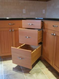 Instead of a lazy susan or blind pullout, how about these angle drawers?                                                                                                                                                      More