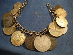 GRANDMAS   ESTATE   BEAUTIFUL   COIN CHARM  BRACELET - I made one of these from my first trip to Europe (pre-Euro) and there were so many neat coins.  My favorites were from Italy and Switzerland. Love Bracelets, Jewelry Bracelets, Necklaces, Coin Jewelry, Jewelery, Vintage Gold Rings, Coin Design, Switzerland, Costume Jewelry
