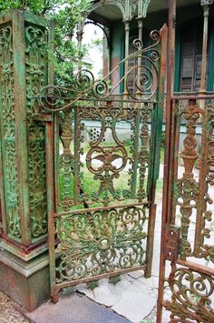 Ironwork in front of an Italianate home on the corner of Washington and Carondelet