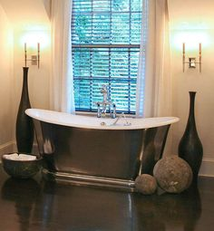 Thom Filicia - Lovely, spa like bathroom design with Waterworks Candide Freestanding Oval bathrub, glossy wood floors, white drapes and black vases