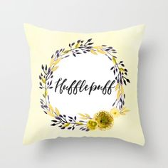 This lovely pillow full of Hufflepuff pride. | Community Post: 22 Bewitching Items All Harry Potter Fans Will Love