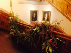 Custom Floral arrangements on wooden railing provided by Emily Thompson flowers for wedding at Brooklyn Historical Society