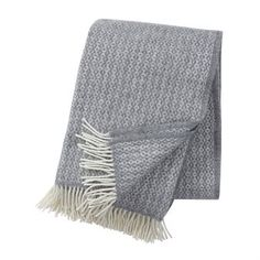 Klippan Yllefabrik was founded in 1879 with a philosophy to combine Swedish design with long tradition of textile craftsmanship. This throw is made of high-quality ecological lambs wool with a beautiful simple pattern and white fringing. Easy to combine with a lot of interior styles and a practical design detail. Available in different colors.