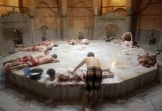 Turkish men and tourists enjoy a traditional bath in the historic Cemberlitas Hamami in Istanbul, Turkey, Tuesday, April. 27, 2010. Cemberlitas Hamami is one of the oldest Turkish Baths in Istanbul, dating back to the late 16th century, and was built by the famous architect Sinan. (AP Photo/Ibrahim Usta)