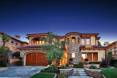 Another mediterranean style home.. I love love love the stone look on the outside of a house.