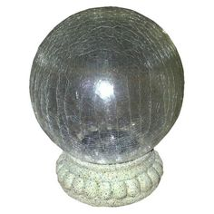 Smart Living Chameleon Solar Gazing Ball with Base $39.99 Glows at Night, Solar-powered Finish: Crackle Protective Qualities: Weather-resistant. General Material: Glass. Care and Cleaning: Wipe Clean with a Damp Cloth. Dimensions: 8.000L x 8.000W x 10.000H