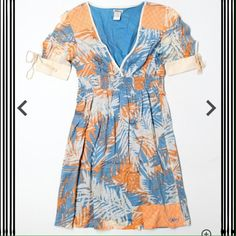Billabong dress Fun tropical print Billabong dress, size medium.  Sleeves have cute ties, shoulders have added design to them. V-neck and empire waist. I accept reasonable offers. Cat friendly home. Billabong Dresses