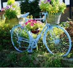 Old bicycle in the garden  I saw something like this in my favorite garden shop...so fun!