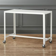 I am slightly obsessed with the idea of having all my furniture on wheels. Go-cart standing desk by CB2.
