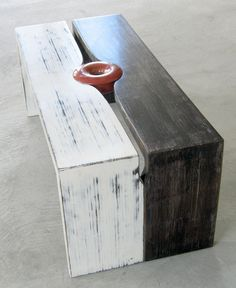 Reclaimed wood bench with non-toxic milk paint finish. Cool idea to use 2 similar components and integrate something in the middle