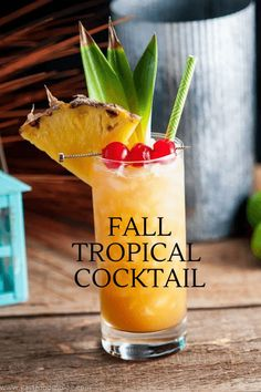 This fall tropical cocktail is perfect anytime of year, but especially in autumn with the use of apple cider! A great flavor combo with rum, apple cider, allspice dram, lime, pineapple juice and peach bitters, this one is a hit! #cocktails #pineapple
