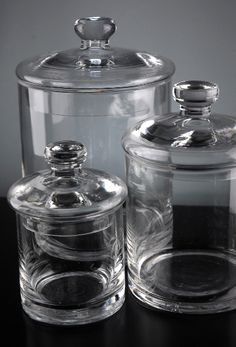 Organization Inexpensive glass jars for bathroom storage.  Add a label or some etching and it would be fabulous!