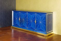 Marquetry credenza with blue dyed veneer, mother of pearl and gold plated plinth and handles