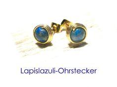 **Ohrstecker Lapis-Lazuli** - aus Golddraht mit Kupferkern umwickelte Lapis-Lazuli-Kugeln. Die Ohrstecker haben einen Durchmesser von ca. 5 mm und vergoldete Verschlüsse. Weitere...