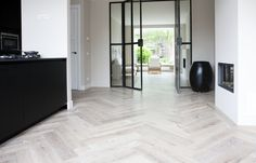 I love the contrast of the herringbone floor with the strong lines of the steel doors House, Luxury Flooring, Home, House Styles, New Homes, House Interior, Herringbone Floor, Flooring, Loft Inspiration