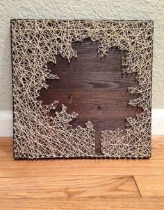Tree string art on hand-stained Dark Walnut with Metallic Gold String  adds as a Beautiful decor piece.