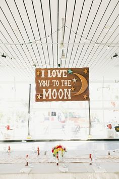 """I love you to the moon"" photo by Onelove Photography http://ruffledblog.com/1920s-inspired-ace-hotel-wedding #signs #reception #weddingideas"