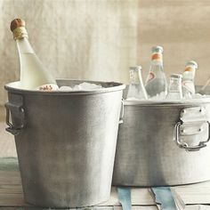 """Chill stow and serve beverages and party fare in style with these sturdy hammered aluminum party buckets.brbrliDimensions: (Wine Bucket) 10""""dia x 9.5""""h (Party Bucket) 18""""w x 8.25""""hliBRBR..."""