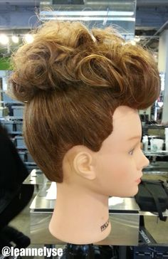 Curly pompadour updo. Sleek sides and curls pinned into a voluminous faux-hawk / pompadour shape // Created by Leann Henderson, Future Professional #803 at Paul Mitchell The School St. Louis // Call (314) 361-8200 to make an appointment! // www.facebook.com/leannhendersonstylist // Instagram: @Leann Henderson