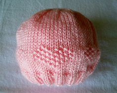 Preemie hat.  If done in worsted and on larger needles, might work for a newborn.