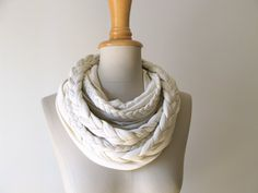 I adore chunky scarves (any any scarf for that matter)!    http://www.etsy.com/listing/99107108/braided-loop-in-vanilla-creme-infinity