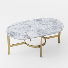 Marble Oval Coffee Table from west elm. Pair with velvet sofa for a luxe look.