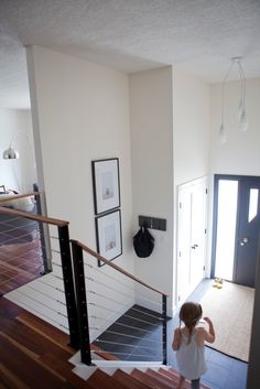Split level entryway.  Think about bumping out the door to give more space in the entry.