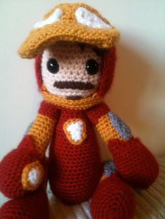 Avengers Iron Man crochet amigurumi doll. $38.95, via Etsy. -how cool would it be to add a mask to him like this one, so he can be both iron man& ^^