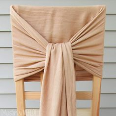 How to Decorate Chairs with Scarves! - Muslin and Merlot Revamp your chair backs in two minutes or less! All you need is a scarf. No-sew tutorial :-). Cheap Chair Covers, Chair Back Covers, Diy Party Chair Covers, Kitchen Chair Covers, Banquet Chair Covers, Chair Ties, Chair Backs, Chair Sashes, Wedding Chair Decorations