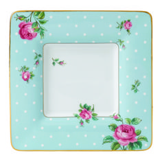 Youthful and exuberant, this Polka Blue Square Trinket Tray makes a beautiful addition to a vanity or desk, and is rendered in fine bone china with intricate detailing, vibrant colors and a lustrous gold rim.