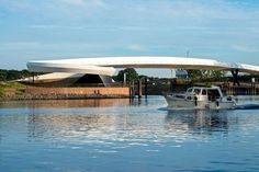 schneider+schumacher have designed a bridge for pedestrians and cyclists at the entrance to the oil terminal harbour, along the River Main in Raunheim, Germany.