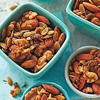 Rosemary Roasted Nuts   3 cups whole unblanched almonds  1 1/2 cups walnuts  1 cup raw pumpkin seeds (pepitas)  2 tablespoons finely snipped fresh rosemary  2 teaspoons packed brown sugar  1 teaspoon sea salt  1/2 teaspoon cayenne pepper  2 tablespoons butter, melted