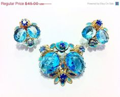 "25% Off - NEW YEAR ""SALE"" Old Vintage Aqua Marine Faceted Glass Brooch and Earring Set. Demi. Flowers. on Etsy, $33.75"